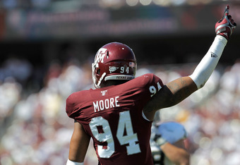 COLLEGE STATION, TX - OCTOBER 15: Damontre Moore #94 of the Texas A&M Aggies celebrates after a play during a game against the Baylor Bears at Kyle Field on October 15, 2011 in College Station, Texas. The Texas A&M Aggies defeated the Baylor Bears 55-28.