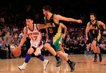 NEW YORK, NY - FEBRUARY 17:  Jeremy Lin #17 of the New York Knicks drives against Greivis Vasquez #21 of the New Orleans Hornets at Madison Square Garden on February 17, 2012 in New York City. NOTE TO USER: User expressly acknowledges and agrees that, by