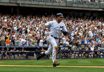 NEW YORK, NY - JULY 09:  Derek Jeter #2 of the New York Yankees rounds the bases after hitting a solo home run in the third inning for career hit 3000 while playing against the Tampa Bay Rays at Yankee Stadium on July 9, 2011 in the Bronx borough of New Y