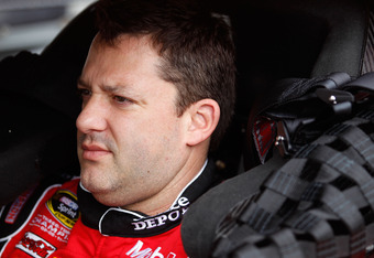 DAYTONA BEACH, FL - FEBRUARY 18:  Tony Stewart, driver of the #14 Office Depot/Mobil 1 Chevrolet, sits in his car in the garage during practice for the NASCAR Sprint Cup Series Daytona 500 at Daytona International Speedway on February 18, 2012 in Daytona