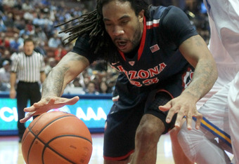 ANAHEIM, CA - JANUARY 05:  Jesse Perry #33 of the Arizona Wildcats goes for a loose ball against the UCLA Bruins at the Honda Center on January 5, 2012 in Anaheim, California.  UCLA won 65-58.  (Photo by Stephen Dunn/Getty Images)