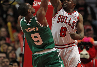CHICAGO, IL - FEBRUARY 16:  Rajon Rondo #9 of the Boston Celtics shoots against Mike James #8 of the Chicago Bulls at the United Center on February 16, 2012 in Chicago, Illinois. The Bulls defeated the Celtics 89-80. NOTE TO USER: User expressly acknowled