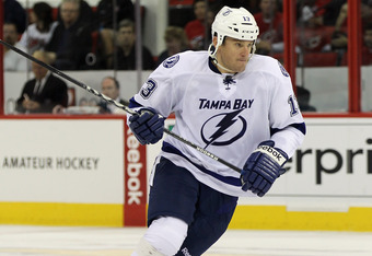 RALEIGH, NC - OCTOBER 07:  Pavel Kubina #13 of the Tampa Bay Lightning skates against the Carolina Hurricanes at the RBC Center on October 7, 2011 in Raleigh, North Carolina. The Lightning defeated the Hurricanes 5-1.  (Photo by Bruce Bennett/Getty Images