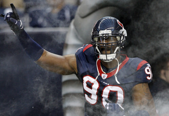 HOUSTON - AUGUST 28:  Defensive end Mario Williams #90 of the Houston Texans is introduced before a preseason game against the Dallas Cowoys at Reliant Stadium on August 28, 2010 in Houston, Texas.  (Photo by Bob Levey/Getty Images)
