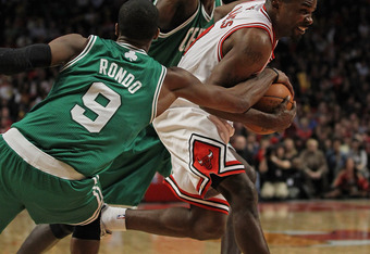 Defensive dynamo Rajon Rondo gets all ball on Mike James.
