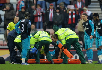 SUNDERLAND, ENGLAND - FEBRUARY 11: Per Mertesacker of Arsenal is put on a stretcher as he is substituted after suffering an injury during the Barclays Premier League match between Sunderland and Arsenal at the Stadium of Light on February 11, 2012 in Sund