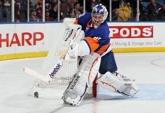 UNIONDALE, NY - FEBRUARY 11:  Evgeni Nabokov #20 of the New York Islanders in action against the Los Angeles Kings on February 11, 2012 at Nassau Coliseum in Uniondale, New York. The Islanders defeated the Kings 2-1 in overtime.  (Photo by Jim McIsaac/Get
