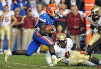 GAINESVILLE, FL - NOVEMBER 26:  Running back Chris Rainey #1 of the Florida Gators rushes upfield against the Florida State Seminoles November 26, 2011 at Ben Hill Griffin Stadium in Gainesville, Florida.  FSU won 21 - 7.  (Photo by Al Messerschmidt/Getty