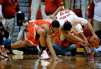 LINCOLN, NE - JANUARY 21: Bo Spencer #23 of the Nebraska Cornhuskers and Lenzelle Smith Jr. #32 of the Ohio State Buckeyes fight for a loose ball during their game at The Devany Center January 21, 2012 in Lincoln, Nebraska. Ohio State defeated Nebraska 78