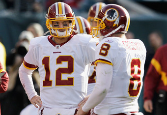 PHILADELPHIA, PA - JANUARY 01: Quarterbacks John Beck #12 and Rex Grossman #8 of the Washington Redskins talk on the sidelines against the Philadelphia Eagles at Lincoln Financial Field on January 1, 2012 in Philadelphia, Pennsylvania.  (Photo by Rob Carr