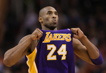 PHOENIX, AZ - FEBRUARY 19:  Kobe Bryant #24 of the Los Angeles Lakers adjusts his jersey during the NBA game against the Phoenix Suns at US Airways Center on February 19, 2012 in Phoenix, Arizona. The Suns defeated the Lakers 102-90. NOTE TO USER: User ex