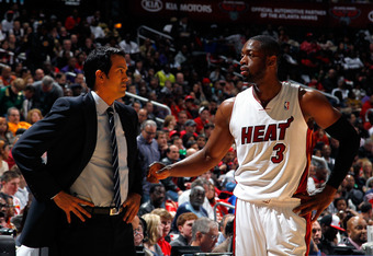 ATLANTA, GA - FEBRUARY 12:  Erik Spoelstra and Dwyane Wade #3 of the Miami Heat converse against the Atlanta Hawks at Philips Arena on February 12, 2012 in Atlanta, Georgia.  NOTE TO USER: User expressly acknowledges and agrees that, by downloading and or