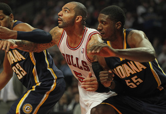 CHICAGO, IL - DECEMBER 20: Carlos Boozer #5 of the Chicago Bulls sets for a rebound between Danny Granger #33 and Roy Hibbert #55 of the Indiana Pacers at the United Center on December 20, 2011 in Chicago, Illinois. The Bulls defeated the Pacers 93-85. NO