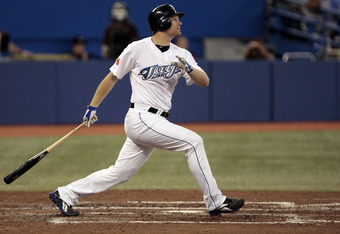 TORONTO, CANADA - AUGUST 29:  Adam Lind #26 of the Toronto Blue Jays hits a two-run home run during MLB action against the Tampa Bay Rays at the Rogers Centre August 29, 2011 in Toronto, Ontario, Canada. (Photo by Abelimages/Getty Images)