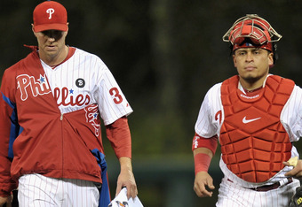 PHILADELPHIA, PA - OCTOBER 07:  (L-R) Roy Halladay #34 and Carlos Ruiz #51 of the Philadelphia Phillies walk across the outfield from the bullpen prior to playing against the St. Louis Cardinals during Game Five of the National League Divisional Series at