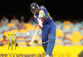 BRISBANE, AUSTRALIA - FEBRUARY 21:  Mahela Jayawardena of Sri Lanka hits the ball to the boundary for a four during game eight of the One Day International Series between India and Sri Lanka at The Gabba on February 21, 2012 in Brisbane, Australia.  (Phot