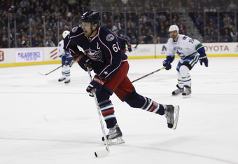 COLUMBUS, OH - DECEMBER 13:  Rick Nash #61 of the Columbus Blue Jackets skates the puck up ice during the game against the Vancouver Canucks at Nationwide Arena on December 13, 2011 in Columbus, Ohio.  The Blue Jackets defeated the Canucks 2-1.  (Photo by