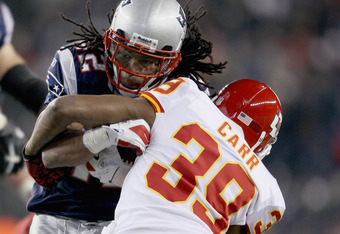 FOXBORO, MA - NOVEMBER 21:   BenJarvus Green-Ellis #42 of the New England Patriots is tackled by  Brandon Carr #39 of the Kansas City Chiefs on November 21, 2011 at Gillette Stadium in Foxboro, Massachusetts.  (Photo by Elsa/Getty Images)