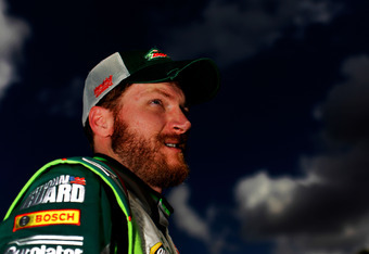 DAYTONA BEACH, FL - FEBRUARY 19:  Dale Earnhardt Jr., driver of the #88 Diet Mountain Dew/National Guard Chevrolet, looks on after qualifying for the NASCAR Sprint Cup Series Daytona 500 at Daytona International Speedway on February 19, 2012 in Daytona Be