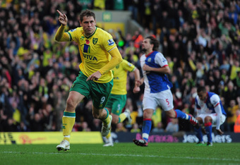 NORWICH, ENGLAND - OCTOBER 29:  Grant Holt of Norwich City celebrates his goal during the Barlclays Premier League match between Norwich City and Blackburn Rovers at Carrow Road on October 29, 2011 in Norwich, England.  (Photo by Jamie McDonald/Getty Imag