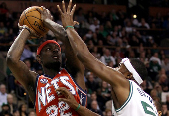 BOSTON, MA - JANUARY 04:  Anthony Morrow #22 of the New Jersey Nets tries to shoot over Keyon Dooling #51 of the Boston Celtics on January 4, 2012 at TD Garden in Boston, Massachusetts. The Boston Celtics defeated the New Jersey Nets 89-70. NOTE TO USER: