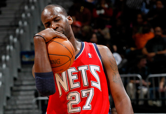 ATLANTA, GA - DECEMBER 30:  Johan Petro #27 of the New Jersey Nets reacts after a foul against the Atlanta Hawks at Philips Arena on December 30, 2011 in Atlanta, Georgia.  NOTE TO USER: User expressly acknowledges and agrees that, by downloading and or u