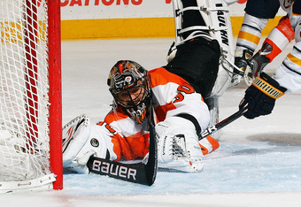 PHILADELPHIA, PA - FEBRUARY 16:  Ilya Bryzgalov #30 of the Philadelphia Flyers makes a save from a shot by Ville Leino #23 of the Buffalo Sabres during their game on February 16, 2012 at The Wells Fargo Center in Philadelphia, Pennsylvania.  (Photo by Al