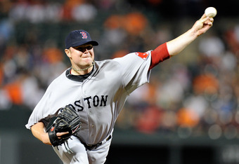 BALTIMORE, MD - SEPTEMBER 28:  Jon Lester #31 of the Boston Red Sox pitches against the Baltimore Orioles at Oriole Park at Camden Yards on September 28, 2011 in Baltimore, Maryland.  (Photo by Greg Fiume/Getty Images)