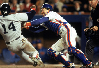 FLUSHING, NY - OCTOBER 27:  Catcher Gary Carter #8 of the New York Mets tags out Jim Rice #14 of the Boston Red Sox during game 7 of the 1986 World Series at Shea Stadium on October 27, 1986 in Flushing, New York. The Mets won the series 4-3.  (Photo by T