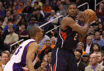 PHOENIX, AZ - FEBRUARY 15:  Joe Johnson #2 of the Atlanta Hawks looks to pass during the NBA game against the Phoenix Suns at US Airways Center on February 15, 2012 in Phoenix, Arizona. The Hawks defeated the Suns 101-99.  NOTE TO USER: User expressly ack