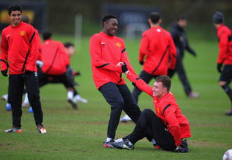 MANCHESTER, ENGLAND - FEBRUARY 22: Danny Welbeck  helps Phil Jones up from the floor during the Manchester United training ahead of their UEFA Europa League round of 32 second leg match against Ajax session at the Carrington Training Ground on February 22