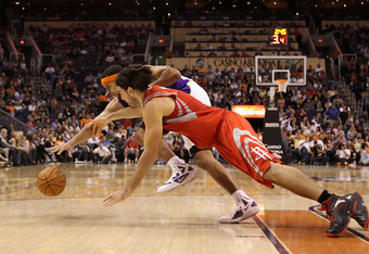 PHOENIX, AZ - FEBRUARY 09:  Jared Dudley #3 of the Phoenix Suns and Luis Scola #4 of the Houston Rockets dive for a loose ball during the NBA game at US Airways Center on February 9, 2012 in Phoenix, Arizona. The Rockets defeated the Suns 96-89.  NOTE TO
