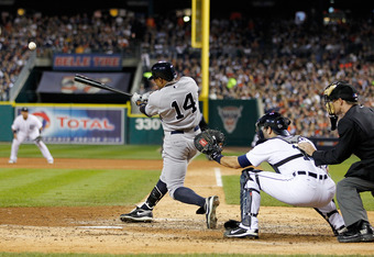 DETROIT, MI - OCTOBER 04:  Curtis Granderson #14 of the New York Yankees hits an RBI double against the Detroit Tigers in the fifth inning of Game Four of the American League Division Series at Comerica Park on October 4, 2011 in Detroit, Michigan.  (Phot