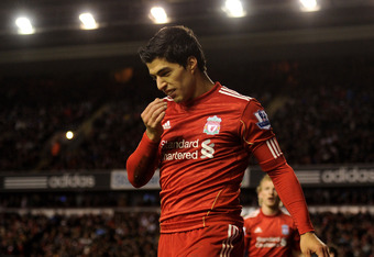 LIVERPOOL, ENGLAND - FEBRUARY 19:  Luis Suarez of Liverpool reacts after missing a penalty kick during the FA Cup Fifth Round match between Liverpool and Brighton & Hove Albion at Anfield on February 19, 2012 in Liverpool, England.  (Photo by Michael Rega