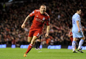LIVERPOOL, ENGLAND - JANUARY 25:  Craig Bellamy of Liverpool celebrates scoring his team's second goal during the Carling Cup Semi Final Second Leg match between Liverpool and Manchester City at Anfield on January 25, 2012 in Liverpool, England.  (Photo b