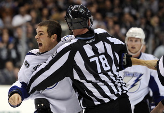 LOS ANGELES, CA - NOVEMBER 04:  Steve Downie #9 of the Tampa Bay Lightning is restrained after his fight with Willie Mitchell #33 of the Los Angeles Kings during the third period at Staples Center on November 4, 2010 in Los Angeles, California. The Kings