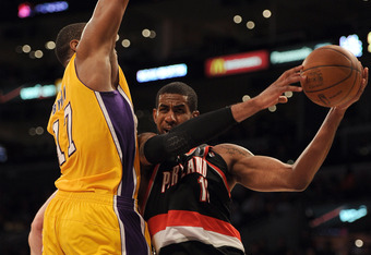 LOS ANGELES, CA - FEBRUARY 20:  LaMarcus Aldridge #12 of the Portland Trail Blazers is fouled by Andrew Bynum #17 of the Los Angeles Lakers during the second half at Staples Center on February 20, 2012 in Los Angeles, California. The Lakers won 103-92.  N