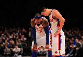 NEW YORK, NY - FEBRUARY 20: Carmelo Anthony #7 and Jeremy Lin #17 of the New York Knicks stand on the court against the New Jersey Nets at Madison Square Garden on February 20, 2012 in New York City. NOTE TO USER: User expressly acknowledges and agrees th
