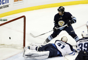 PITTSBURGH, PA - FEBRUARY 11:  Kris Letang #58 of the Pittsburgh Penguins scores past Ondrej Pavelec #31 of the Winnipeg Jets during the game at Consol Energy Center on February 11, 2012 in Pittsburgh, Pennsylvania.  (Photo by Justin K. Aller/Getty Images