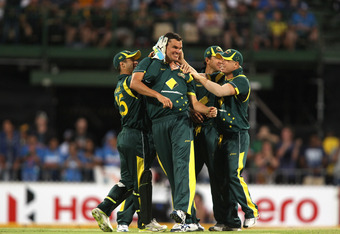 ADELAIDE, AUSTRALIA - FEBRUARY 12: Clint McKay (C) of Australia is congratulated by team mates after he got the wicket of Gautam Gambhir of India during game four of the One Day International Series between Australia and India at Adelaide Oval on February