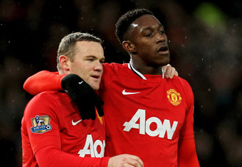 MANCHESTER, ENGLAND - DECEMBER 10:  (L-R) Wayne Rooney of Manchester United is congratulated by teammate Danny Welbeck after scoring his team's second goal during the Barclays Premier League match between Manchester United and Wolverhampton Wanderers at O