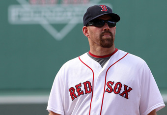 BOSTON - AUGUST 17:  Kevin Youkilis #20 of the Boston Red Sox looks away moments before a 4-0 lose to the Tampa Bay Rays at Fenway Park on August 17, 2011 in Boston, Massachusetts.  (Photo by Jim Rogash/Getty Images)