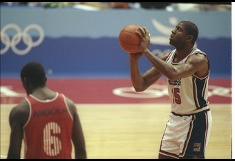 26 Jul 1992:  Guard Earvin 'Magic' Johnson of the United States looks  to shoot the ball during a game against Angola at the Olympic Games in Barcelona, Spain. Mandatory Credit: Mike Powell  /Allsport