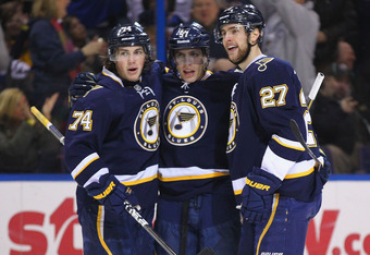 ST. LOUIS, MO - FEBRUARY 11: T.J. Oshie #74, David Perron #57 and Alex Pietrangelo #27 of the St. Louis Blues celebrate Perron's second goal against the Colorado Avalanche at the Scottrade Center  on February 11, 2012 in St. Louis, Missouri.  (Photo by Di