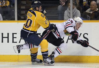 NASHVILLE, TN - FEBRUARY 14: Ryan Suter #20 of the Nashville Predators knocks down Jonathan Toews #19 of the Chicago Blackhawks at the Bridgestone Arena on February 14, 2012 in Nashville, Tennessee.  (Photo by Bruce Bennett/Getty Images)