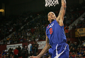OKLAHOMA CITY, OK - OCTOBER 23: Michael Beasley of Team Blue goes to the net during the US Fleet Tracking Basketball Invitational charity basketball game October 23, 2011 at the Cox Convention Center in Oklahoma City, Oklahoma.  The game benefitted the Si