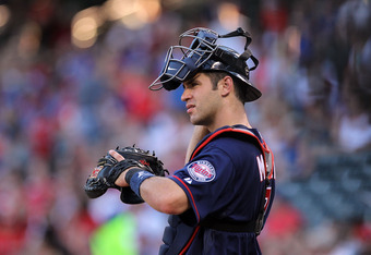 ARLINGTON, TX - JULY 27:  Joe Mauer #7 of the Minnesota Twins at Rangers Ballpark in Arlington on July 27, 2011 in Arlington, Texas.  (Photo by Ronald Martinez/Getty Images)