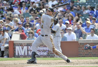 CHICAGO, IL - SEPTEMBER 03:  Ryan Doumit #41 of the Pittsburgh Pirates follows through on an RBI double scoring Neil Walker during the fourth inning at Wrigley Field on September 3, 2011 in Chicago, Illinois.  (Photo by Brian Kersey/Getty Images)