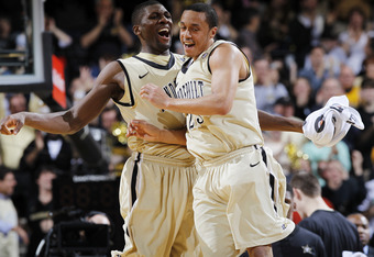 NASHVILLE, TN - FEBRUARY 11: John Jenkins #23 and Festus Ezeli #3 of the Vanderbilt Commodores celebrate during the game against the Kentucky Wildcats at Memorial Gymnasium on February 11, 2012 in Nashville, Tennessee. Kentucky won 69-63. (Photo by Joe Ro