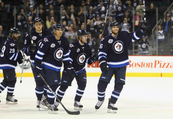 WINNIPEG, MB - FEBRUARY 23: Mark Flood #36 Bryan Little #18 Evander Kane #9 Nik Antropov #80 and Johnny Oduya #29 of the Winnipeg Jets salute the fans after their victory during their NHL game against the Tampa Bay Lightning at MTS Centre on February 23,